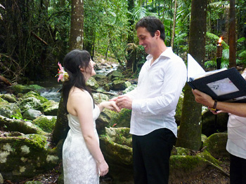 Damian places the ring on Clare's finger at their Wedding with Marry Me Marilyn at Crystal Creek Rainforest Retreat in Crystal Creek Northern NSW