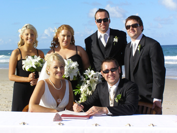 David Signs the Marriage Certificate with Angela and thier Wedding Party at palm Beach on the Gold Coast