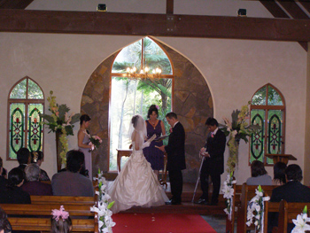 kaoru Reads her Wedding Vows to Adam in a quaint chapel on the Central Gold Coast with Marilyn Verschuure from Marry Me Marilyn