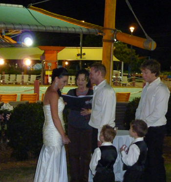 Kate & Ben had a Family Unity Cerremony for their sons as part of their Wedding Ceremony at WhiteWater World by the wave pool in Dreamworld with Marry Me Marilyn.