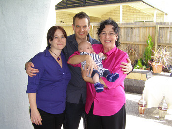 Marilyn Holds Baby Elijah For His Naming Ceremony at his Home in Warner in North Brisbane