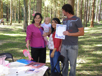 Marilyn Presents Tia's parent Jason and Anastasia with a Butterfly Namegiving Certificate to match her Naming Day Theme
