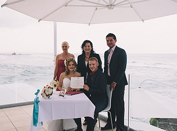 Olga and Alex were married my Marry Me Marilyn on the deck of the Currumbin Beach Surf Lifesaving Club