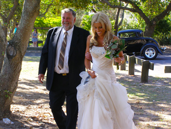 Sara's Father walks her to the Aisle
