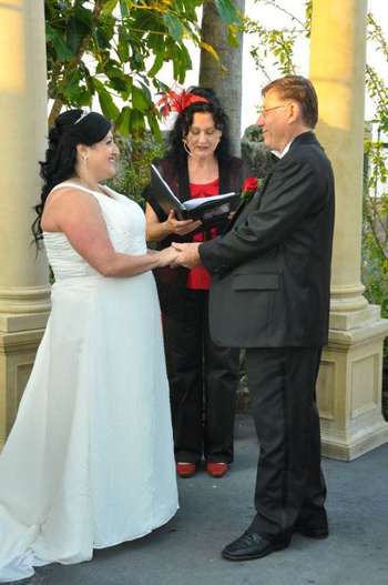 Marry Me Marilyn ties the Handfasting Ribbons of Love around Sylvia & Chris' Hands at the Courthouse Restaurant in Cleveland Point